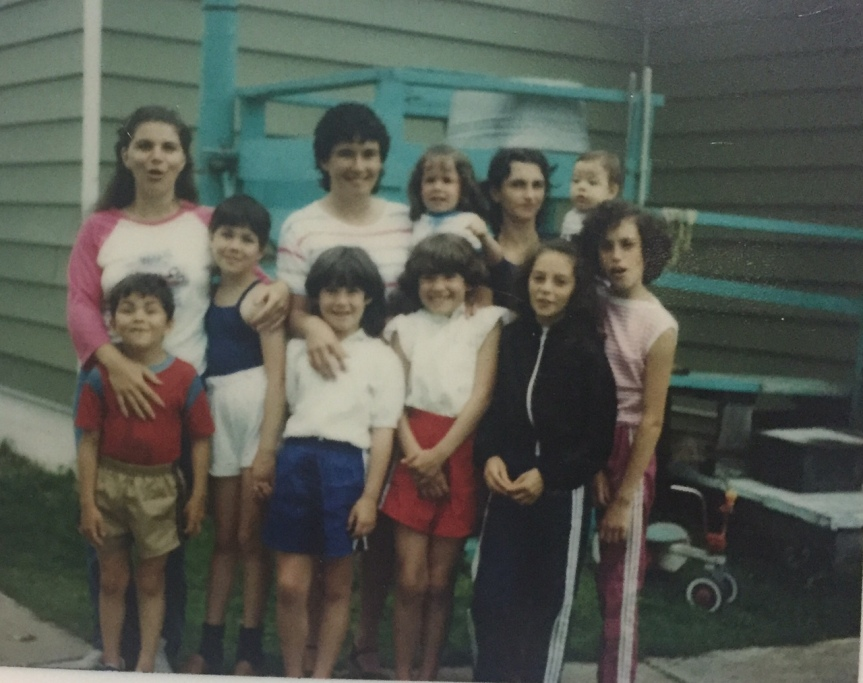 Here we all are in the backyard of the house. Note the washing and drying behind us.